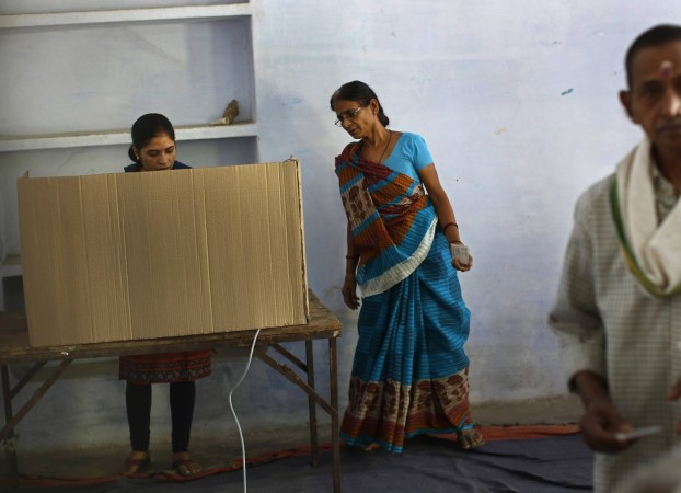 Women at a polling station in the final phase of the general election in Varanasi