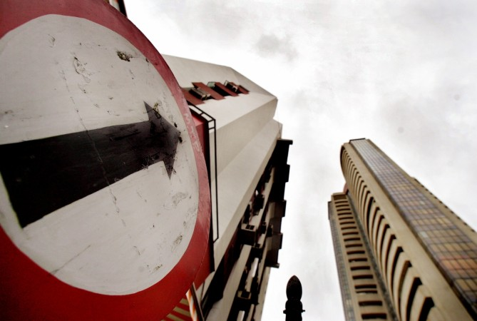 A road sign stands next to the Bombay Stock Exchange building (Reuters)