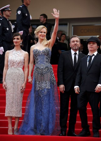"Director Olivier Dahan, cast members Paz Vega, Nicole Kidman, Tim Roth pose on the red carpet as they arrive for the opening ceremony and the screening of the film ""Grace of Monaco"" out of competition during the 67th Cannes Film Festival in Cannes"