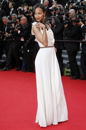 Actress Zoe Saldana poses on the red carpet as she arrives for the opening ceremony of the 67th Cannes Film Festival in Cannes