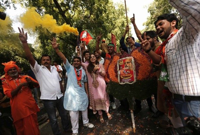 Supporters of India's BJP hold a portrait of Hindu nationalist Modi during the celebrations in New Delhi