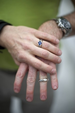 A couple displays wedding rings at rally on Pennsylvania State Capital steps after ruling struck down ban on same-sex marriage in Harrisburg, Pennsylvania