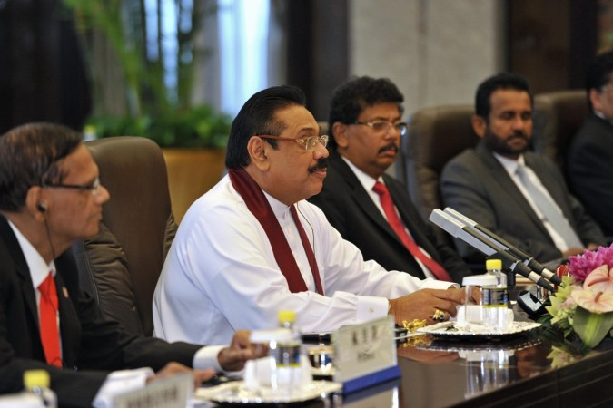Sri Lankan president Mahinda Rajapaksa has invited the leader of the island country's Tamil province to come with him for Narendra Modi's oath taking ceremony.