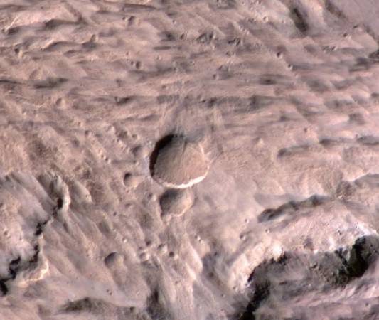 The new Mars crater spans half the length of a football field in this photo from the Mars Reconnaissance Orbiter's sharpest-sighted camera, the High Resolution Imaging Science Experiment.(NASA/JPL-Caltech/University of Arizona)