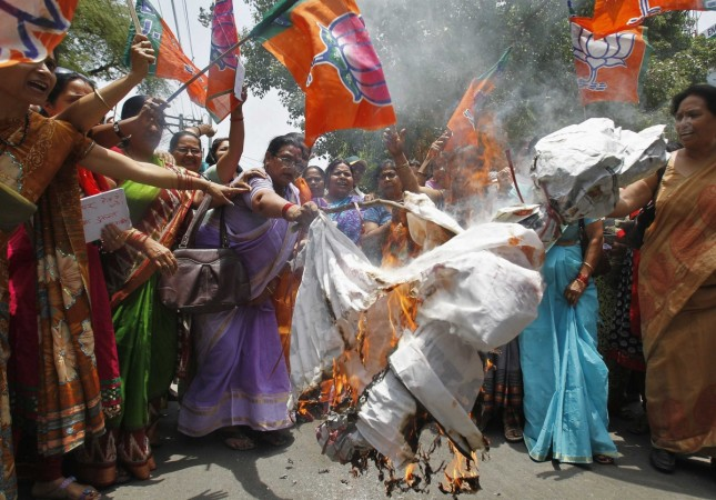 Women workers of India's ruling BJP burn effigy of Yadav, chief minister of Uttar Pradesh, during protest against recent killings of two girls, in Allahabad  (2014-05-31)