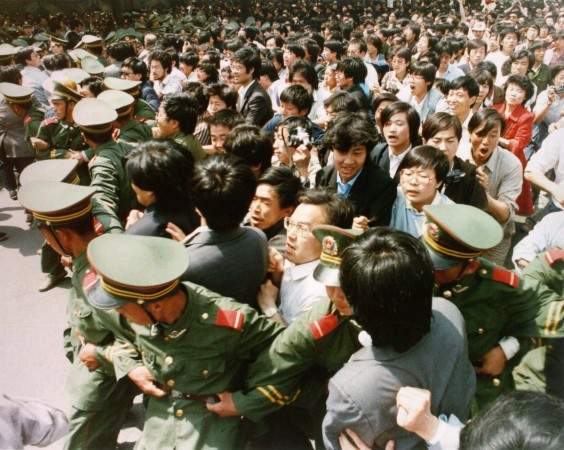 File photo of crowds of jubilant students surging through a police cordon before pouring into Tiananmen Square