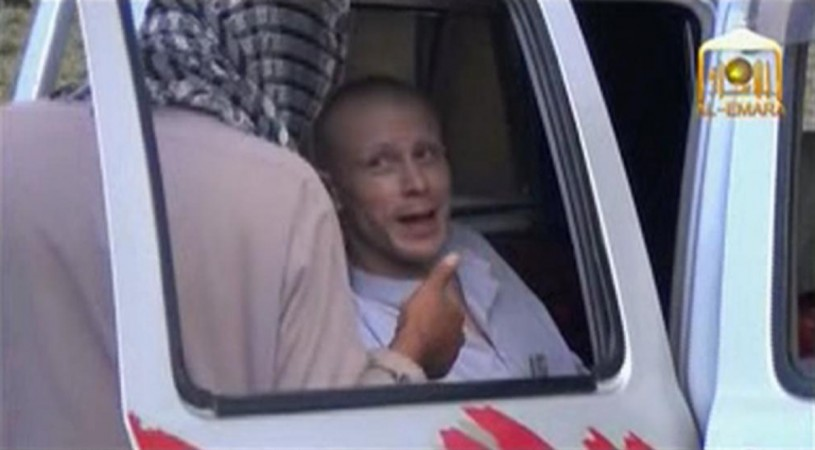 U.S. Army Sergeant Bowe Bergdahl waits in a pick-up truck before he is freed at the Afghan border