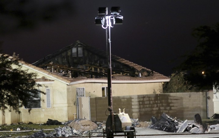 A damaged house is seen at the scene of a U.S. military jet crash in Imperial, California