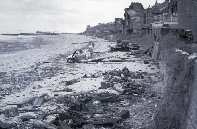Handout photo of a crashed U.S. fighter plane on the waterfront on a Juno Beach D-Day landing zone in Saint-Aubin-sur-Mer