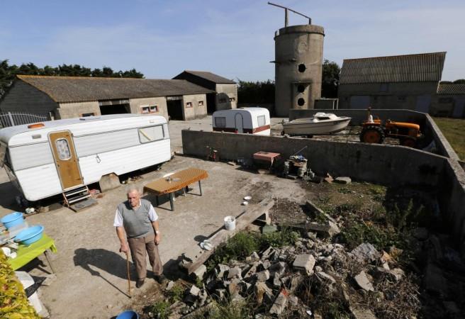 Farmer Bertot poses on his property near the former D-Day landing zone of Utah Beach in Les Dunes de Varreville