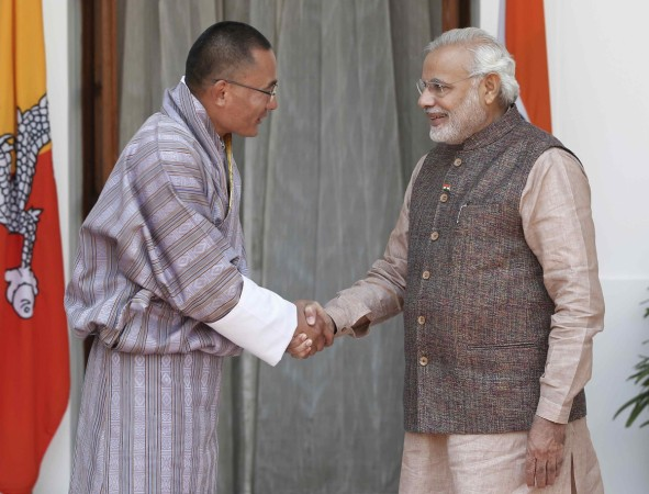 India's PM Modi shakes hands with his Bhutanese counterpart Tobgay before the start of their bilateral meeting in New Delhi (2014-05-27)
