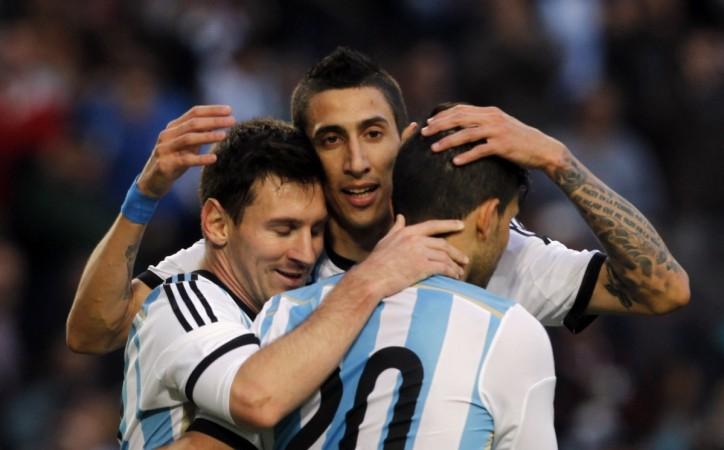 Argentina's Messi embraces team mates Di Maria and Aguero