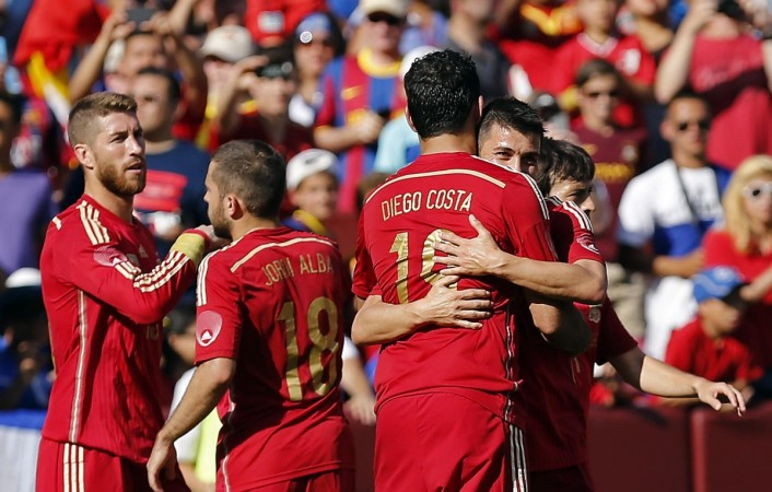 Spain's Villa is congratulated by teammate Costa after he scored his side's second goal against El Salvador