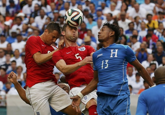 England's Cahill heads the ball away from Honduras' Carlo Costly during an international friendly soccer match in Miami