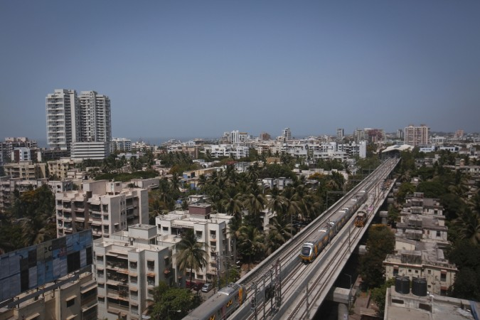 Metro trains pass through a residential area during its first official safety trial run in Mumbai (Reuters, file)