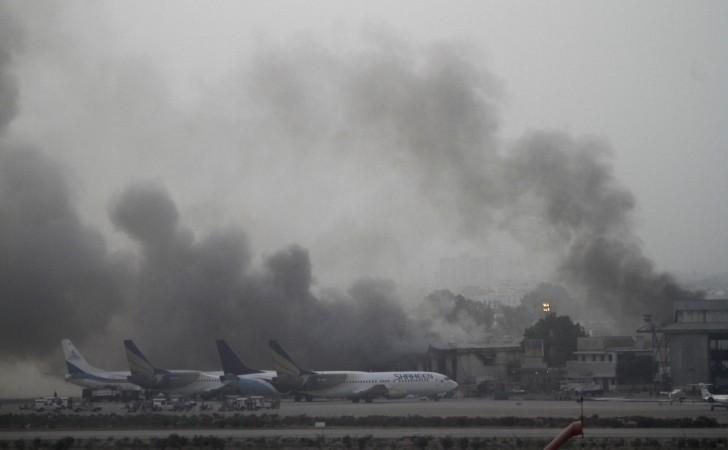 Smoke billows from Jinnah International Airport in Karachi