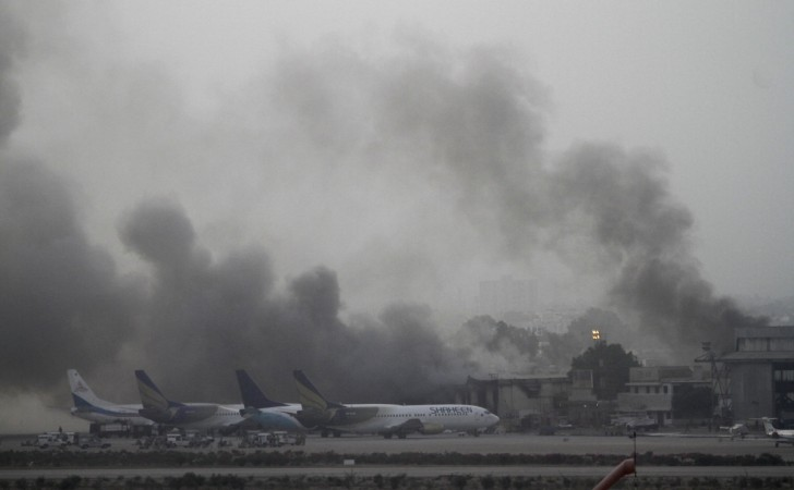 Smoke billows from Jinnah International Airport in Karachi
