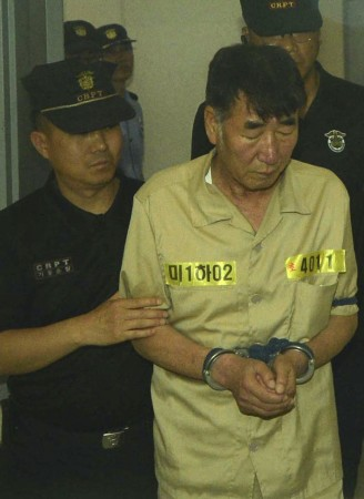 Lee Joon-seok, captain of sunken ferry Sewol, arrives at a court in Gwangju