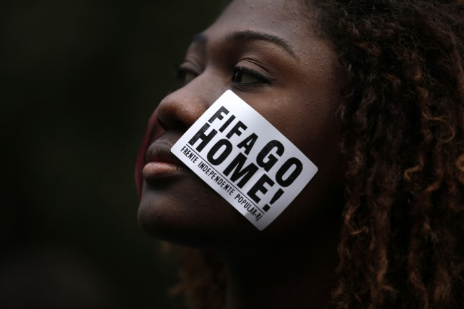 An anti-government demonstrator takes part in a protest against the 2014 World Cup in Rio de Janeiro