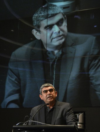 Infosys' CEO Sikka speaks during a news conference at company's headquarters in Bangalore