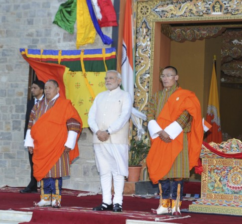 Indian PM Modi and his Bhutanese counterpart Tobgay stand during their bilateral meeting in Thimphu