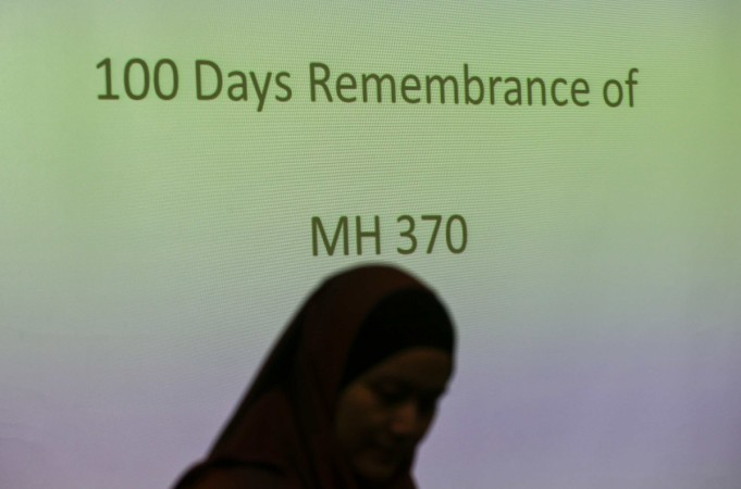 A family member of a Malaysian passenger on board Malaysia Airlines Flight 370 stands near during 100 Days Remembrance of MH370 in Kuala Lumpur