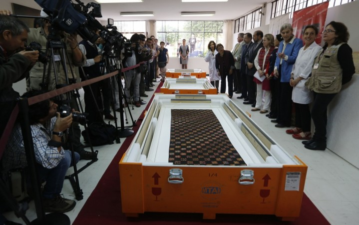 A pre-Inca, Paracas textile, one of the four artefacts recently repatriated from Gothenburg, is displayed to the media at the MNAAHP in Lima (Reuters)