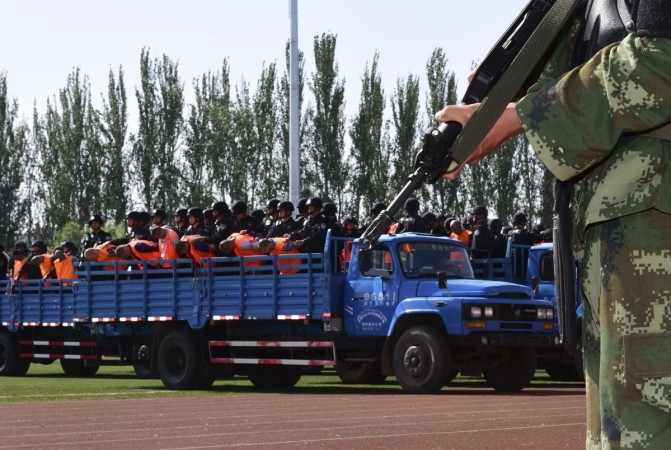 Criminals and suspects are transported to a stadium for a mass sentencing rally in Yili, Xinjiang Uighur Autonomous Region