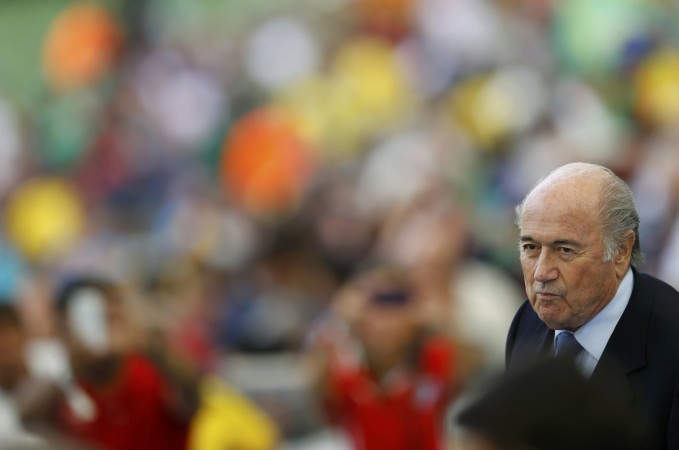 Fifa president Sepp Blatter takes his seat before the 2014 World Cup Group H soccer match between Belgium and Russia at the Maracana stadium in Rio de Janeiro.