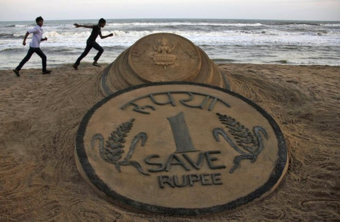 Sand Sculpture of One Rupee Coin