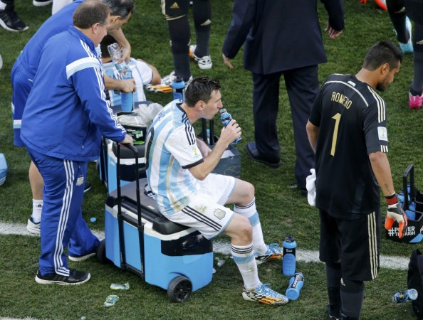 "Argentina captain, Lionel Messi taking an ""energy drink"", hoping to beat fatigue before the extra time of Argentina's Round of 16 match in the FIFA World Cup, 2014, at the Corinthians Arena, in Sao Paolo."