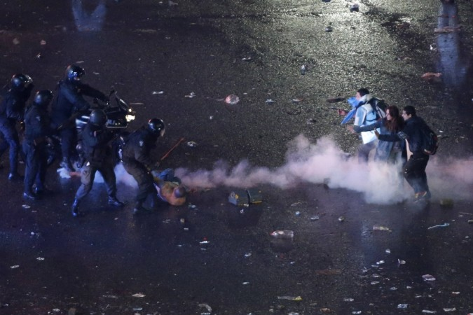 Argentina's fans clash with riot police after Argentina lost to Germany in 2014 World Cup final soccer match in Brazil, at public square viewing area in Buenos Aires