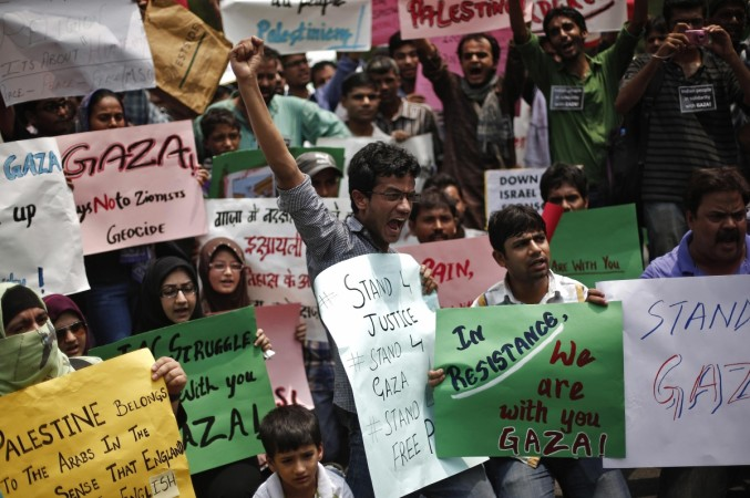 Demonstrators hold placards and shout slogans during a protest rally against the Israel's attacks on Gaza, outside the Israeli embassy in New Delhi
