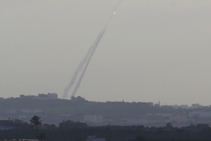 Smoke trails are seen as a rocket is launched from the northern Gaza Strip towards Israel