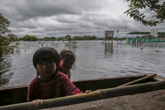 Children are seen in flooded Puerto Almacen, on the outskirts of Trinidad in the northeast region of Beni department, in Bolivia