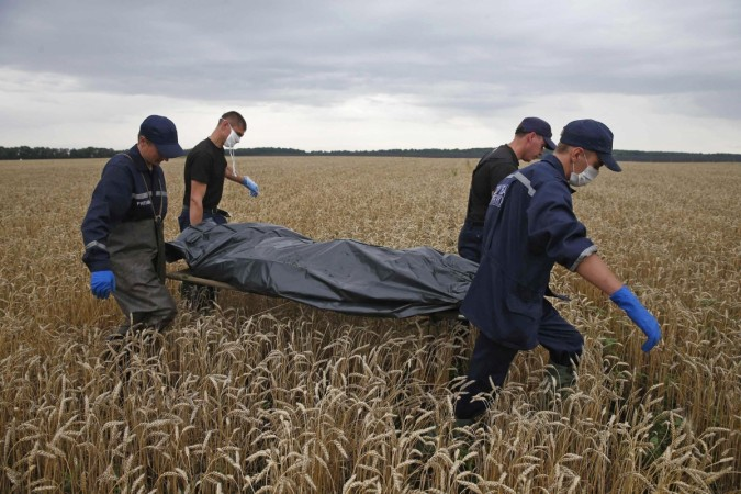 Rescue workers carrying the bodies of MH 17 victims