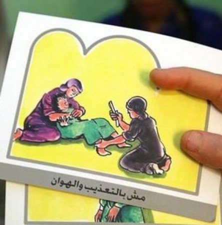 A counselor in Egypt holds up cards used to educate women about female genital mutilation (FGM) in Minia.