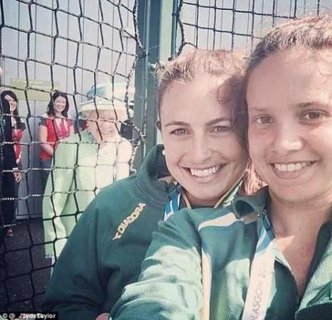 Queen phot-bombing a selfie.