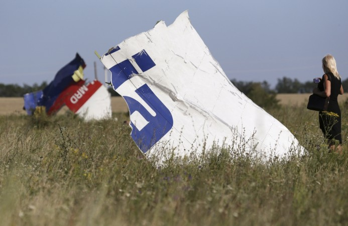 The bodies of up to 80 MH17 victims still remain in the crash site, officials have said.