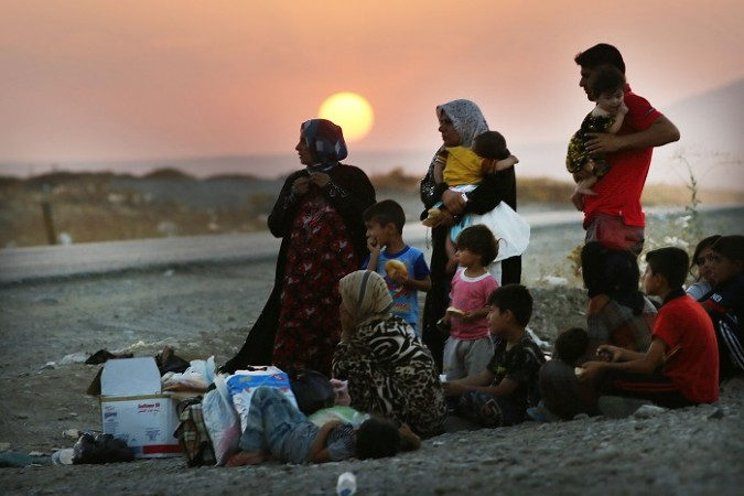 Thousands have fled the Sinjar town as Islamic State militants forced the Kurdish forces guarding the frontiers to retreat.