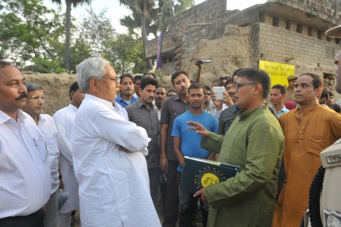Former chief minister Nitish Kumar speaks to Greenpeace activists in Dharnai