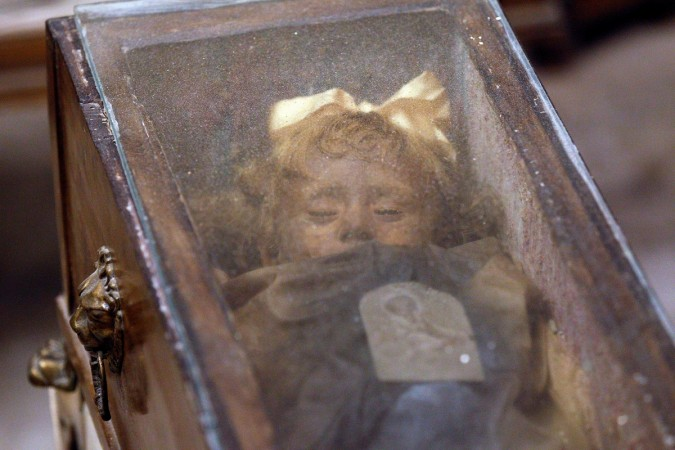 Fully clothed human remains of Rosalia Lombardo, two-years old, representing some of the world's best-preserved bodies, are displayed at the Capuchin Catacombs in Palermo, southern Italy, January 31, 2011.