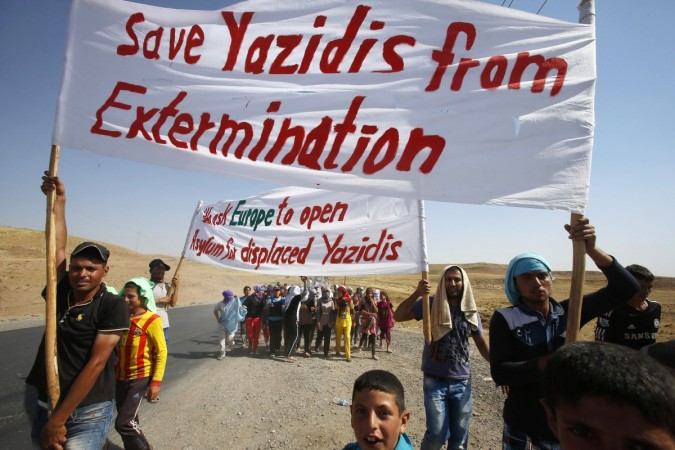 Members of the minority Yazidi sect in Iraq are demanding protection from the ISIS militants-Reuters