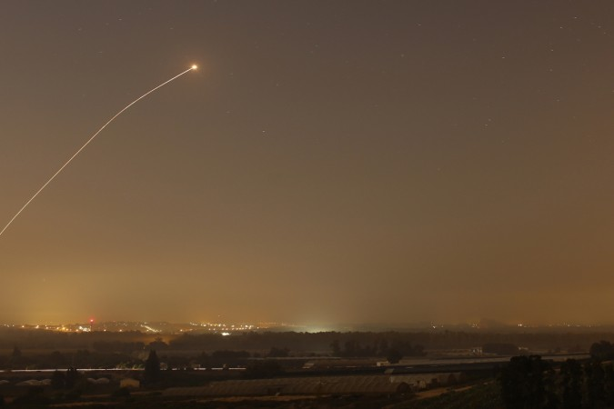An interception by the Iron Dome anti-missile system is seen as rockets are launched from Gaza towards Israel before a 72-hour ceasefire was due to expire August 13, 2014.