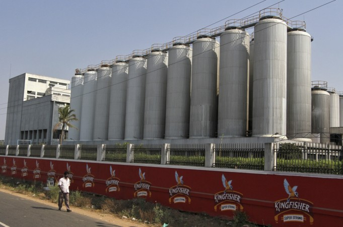 A man walks outside the factory of United Breweries Ltd (UB) that manufactures Kingfisher beer in Thiruvalluar district of the southern Indian state of Tamil Nadu