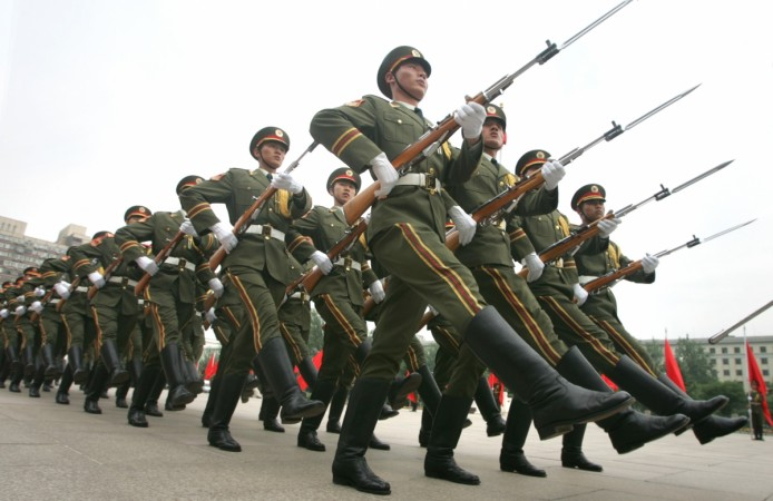 Chinese troops head to first overseas base