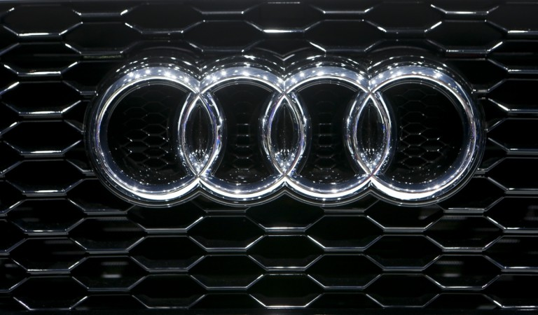 The company logo is seen on the bonnet of a Audi car during the media day ahead of the 84th Geneva Motor Show at the Palexpo Arena in Geneva March 5, 2014.
