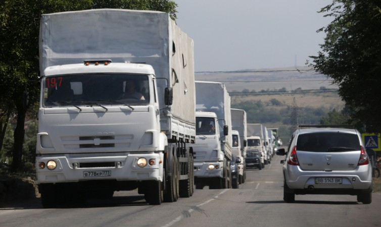 Russian aid convoy of nearly 300 trucks entered the Ukrainian border despite Kiev's objection as reports of artillery fired inside Ukraine.