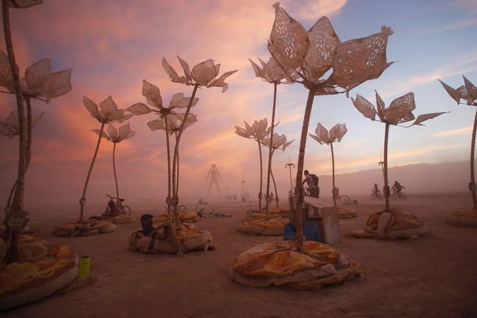 Festival-goers lounge around an art installation called 'Pulse & Bloom'.(Jim Urquhart / Reuters)