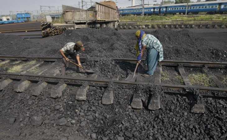 Coal being loaded at a freight station